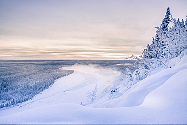 Fog Rises Off Of The Copper River On A Cold Winter Evening, Warm Sunset Light Casting Mount Drum Into Shadows In The Background, Copper River Valley, South-Central Alaska, Alaska, United States Of America