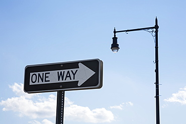 one Way' Traffic Sign And A Street Light, Connecticut, United States Of America
