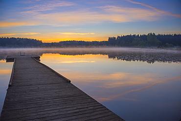 Reflection Of A Beautiful Serene Sunrise On Peaceful Scott Lake, Washington, United States Of America