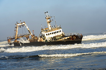 A Rusty Sunken Abandoned Ship In The Waves Of Atlantic Ocean On The Namibian Coast (Zeila Shipwreck), Namibia