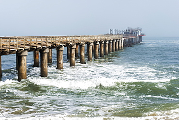 Ocean Pier, Vanishing In The Mist And Atlantic Ocean Waves At Namibia Coast, Namibia