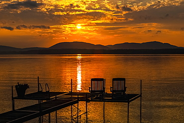 Sunset On Lake With Silhouetted Chairs On Wharf, Knowlton, Quebec, Canada