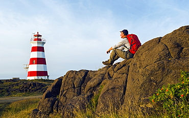 Hiker Looking Out Over Brier Island Lighthouse, Brier Island, Bay Of Fundy, Nova Scotia, Canada