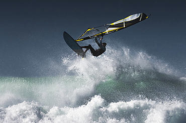 Windsurfer In The Air Above Splashing Waves, Tarifa, Cadiz, Andalusia, Spain