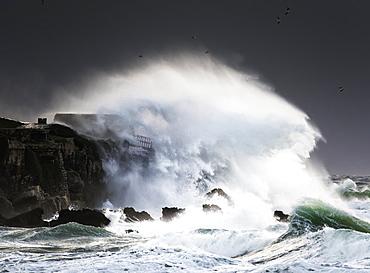 Wave Crashing Into Shore And Splashing Onto The Land Above The Cliffs, Isla De La Palomas, Tarifa, Cadiz, Andalusia, Spain