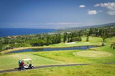Golfers On Golf Course, Kona Country Club, Kailua Kona, Island Of Hawaii, Hawaii, United States Of America