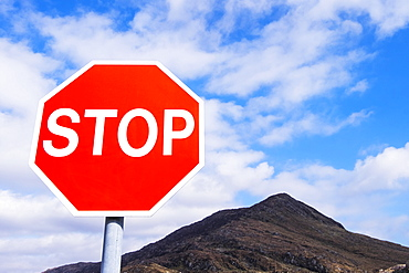 Stop Sign Against A Bright Blue Sky And Mountain Range In Killarney National Park, County Kerry, Ireland