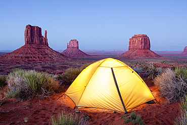 The Mittens And Tent At Dusk, Navajo Tribal Park, Monument Valley, Arizona, United States Of America