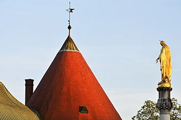 A Peaked Cone Roof With Weather Vane And A Gold Statue Against A Blue Sky, Croatia