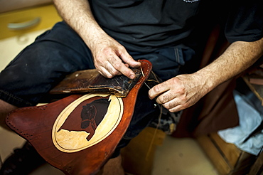 A Craftsman's Hands Working On Leather, Pelotas, Rio Grande Do Sul, Brazil