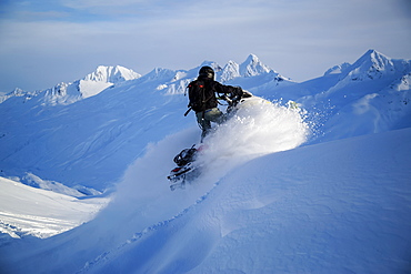 Man Snowmobiling In Thompson Pass Near Valdez, Southcentral Alaska, Winter