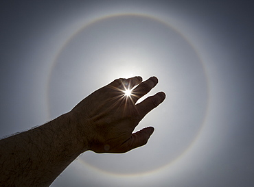 The Sun Piercing Through A Silhouetted Hand, Winnipeg, Manitoba, Canada