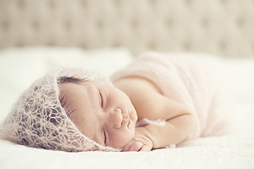 Portrait Of A Newborn Baby Laying On A Bed With White Comforter, Toronto, Ontario, Canada