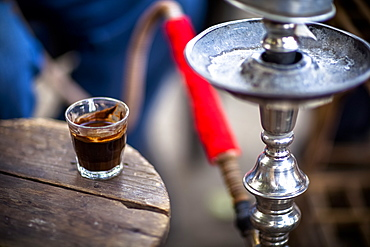 A Glass Of Turkish Coffee Sits By A Sheesha In A Small Village Near Luxor, Egypt