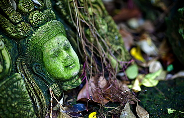 Terra-Cotta Sculpture Of A Thai God Or Perhaps A Temple Attendant Lies In Ruin, Chiang Mai, Thailand