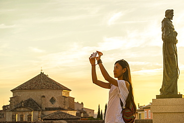 Young Chinese Woman Taking A Picture With Her Phone, Cuenca, Castile-La Mancha, Spain