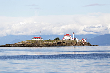 A manned lighthouse station on Entrance Island, near Nanaimo in the Georgia Straight, guides ferry traffic towards the harbour, Nanaimo, British Columbia, Canada