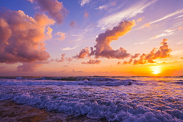 Sunrise over the Atlantic Ocean with the surf washing up on the shore, Indialantic, Florida, United States of America