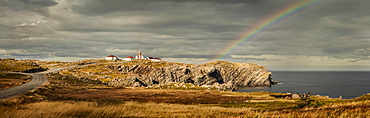 A rainbow across the storm clouds and over the Atlantic ocean and coastline of Newfoundland, Newfoundland, Canada