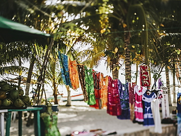 Clothing hanging on display for sale at an outdoor market, Cancun, Mexico