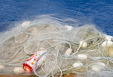A Fishing Net Is Piled On A Dock, Astoria, Oregon, United States Of America