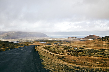 An Asphalt Road Along The Coast Under A Cloudy Sky, Iceland