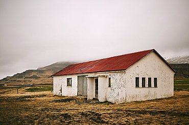 Weathered Building Under Clouds On The Snaefellsnes Peninsula, Iceland