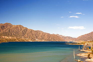 A Lake Surrounded By Colourful Desert Mountains, Potrerillos, Mendoza, Argentina