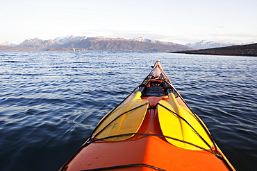 The Tip Of A Canoe Pointing Towards The Kenai Mountains, Kachemak Bay State Park, Alaska, United States Of America