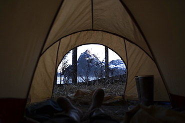 View From Inside A Tent Through The Door To The Rugged Peaks Of The Kenai Mountains, Kachemak Bay State Park, Alaska, United States Of America