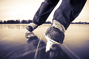 Ice Skating With Hockey Skates On A Frozen Surface, Alaska, United States Of America