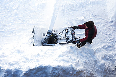 Directly Above A Man Using A Snowblower, Homer, Alaska, United States Of America