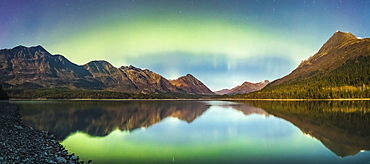 Green Aurora Borealis Lights Up The Night On A Clear Night At Upper Trail Lake In Moose Pass, South-Central Alaska, Alaska, United States Of America