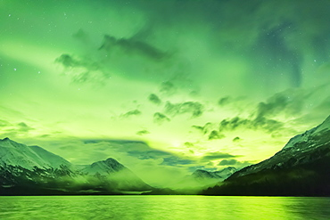 Bright Green Aurora Borealis Dances Over Upper Trail Lake, The Kenai Mountains In The Background, Moose Pass, Kenai Peninsula, South-Central Alaska, Alaska, United States Of America