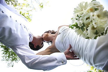 Low Angle View Of A Bride And Groom Kissing On The Wedding Day, Ontario, Canada