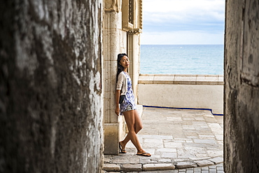 Portrait Of A Chinese Young Woman In Maricel Palace, Sitges, Barcelona Province, Spain