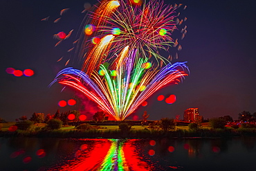 Colourful Fireworks Display Reflected In Water On Canada Day, Edmonton, Alberta, Canada