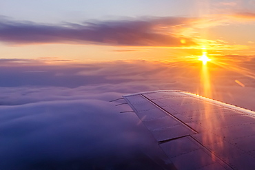 Aerial View Of A Cloudy Sunrise In Winter From The Passenger Seat Of A Commercial Airplane, Interior Alaska, Fairbanks, Alaska, United States Of America