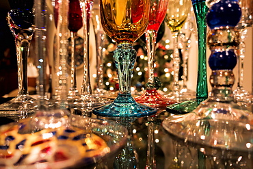 Reflections Of Christmas Tree Lights And Champagne Flutes Sparkle On Shiny Granite Counter, Anchorage, Alaska, United States Of America