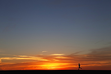 Man Jogging At Sunrise, Chicago, Illinois, United States Of America