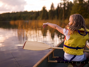 Lake Of The Woods, Ontario, Canada; Girl In A Canoe