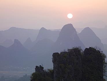 Sun In The Haze Above The Mountains, Guilin, Guangxi, China