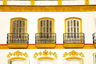 Medina Sidonia, Andalusia, Spain; A White House With Windows And Ledges Trimmed In Gold