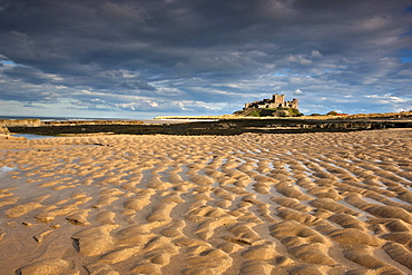 Bamburgh, Northumberland, England; View Of Bamburgh Castle From A Sandy Beach