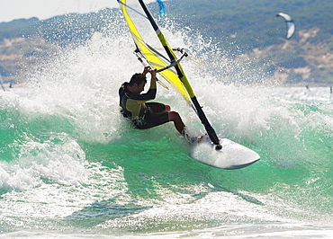 Wind Surfing In The Ocean; Tarifa, Cadiz, Andalusia, Spain