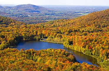 A Lake Surrounded By Forest Area In Autumn; Quebec, Canada