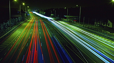 Light Trails Down A Busy Road At Night; Dublin, Ireland
