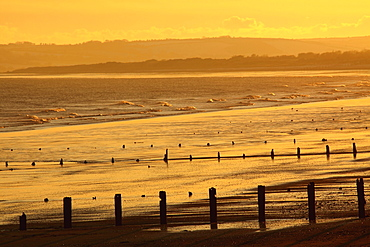 Sunset Over Beach In Winter; Youghal Beach, East Cork, Ireland