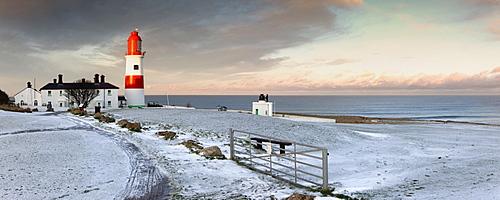 South Shields, Tyne And Wear, England; A Lighthouse And House Along The Coast