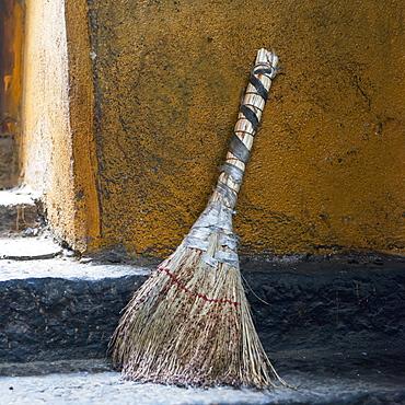 A broom sitting outside a doorway, Lhasa xizang china